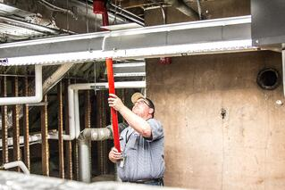 Koorsen Technician Testing Smoke Detector