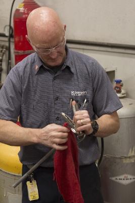 Bob Havlin Cleaning Extinguisher Valve