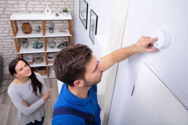 installing carbon monoxide detector on wall